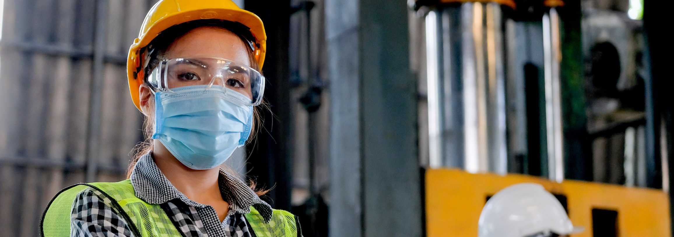Female engineer with a mask on